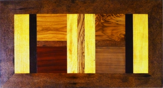 table basse coralie L 110 X P 60 X H 40. 9 essences de bois précieux : ronier, veine, bété, wengué, zingana, padouk, teck, movingué